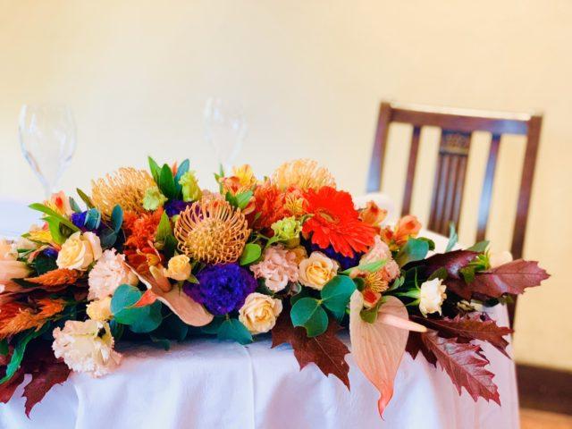 結婚式,装花,メインテーブル,披露宴,ビタミンカラー